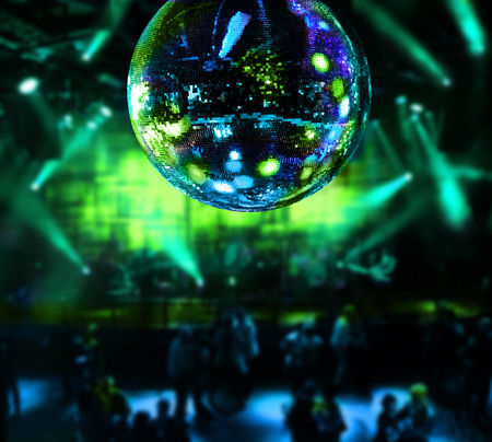 disco lights: Dancing under disco mirror ball night club background