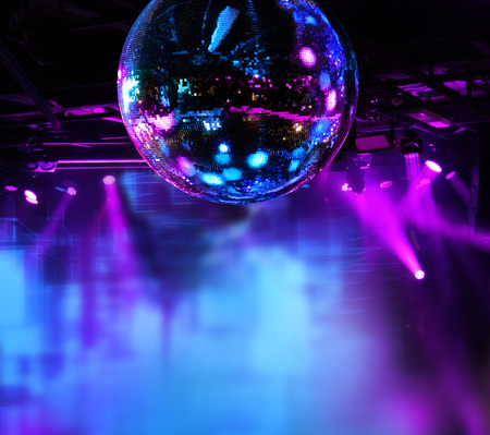 club: Colorful disco mirror ball lights night club background
