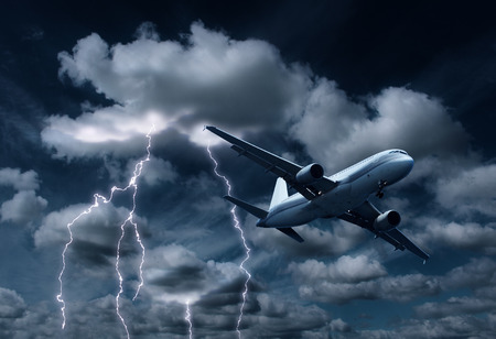 yielding: Passenger aeroplane yielding turbulent thunderstorm and lightnings