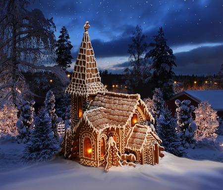 Gingerbread church on snowy Christmas night