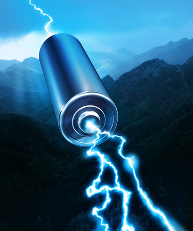 alkaline: Energy power battery blue sparks on mountain silhouette background Stock Photo