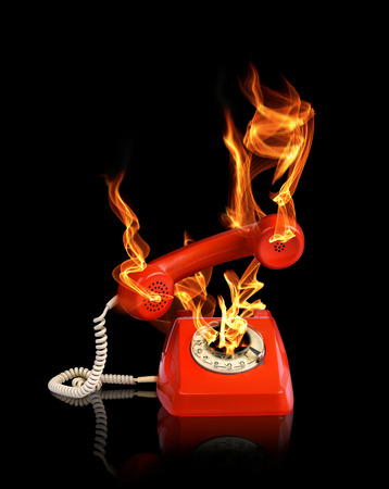 hot line: Hot line phone in fire flames black backround