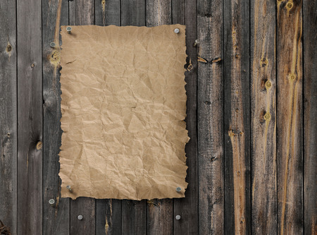 Empty Wild West wanted poster on weathered plank wood wall