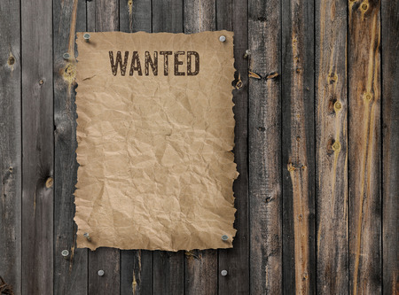 Wild West wanted poster on weathered plank wood wall