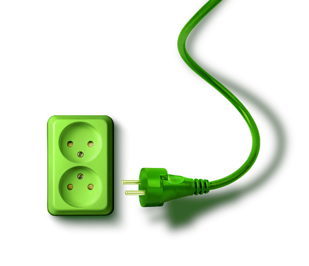 electrical energy: Green electrical socket and plugs renewable eco energy concept Stock Photo