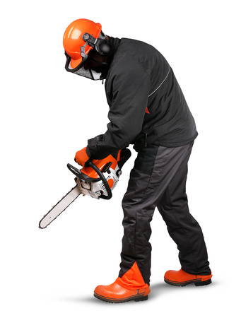 logger: Professional logger using chain saw with safety gear on