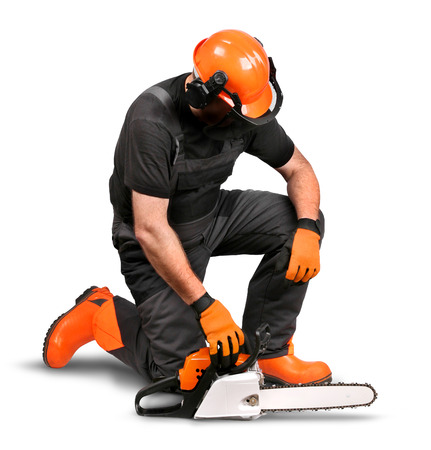 logger: Professional logger resting with chain saw, safety gear on