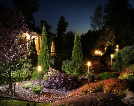 Home garden illumination autumn evening lights patio Foto de archivo