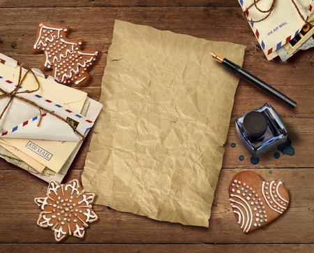 bisquit: Christmas wish list letter to Santa on old wooden table background Stock Photo
