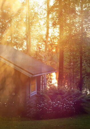 Finnish sauna cottage in luminous midsummer night lakeside feeling