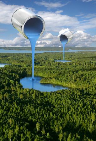 Creating blue lakes by pouring paint, forest and lake district aerial view Фото со стока