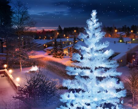 Winter feeling snowy home street evening with beautifully lit Christmas tree Stock Photo
