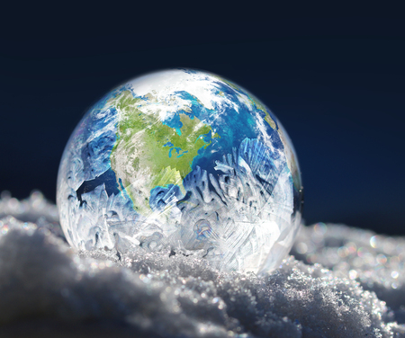 Frozen planet Earth freezing ice globe climate change concept