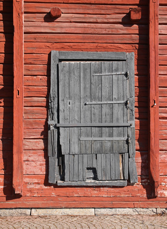 Old weathered wooden magazine warehouse door