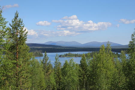 Finnish Lapland summer lake scenery with Pallastunturi fells on the horizon 版權商用圖片