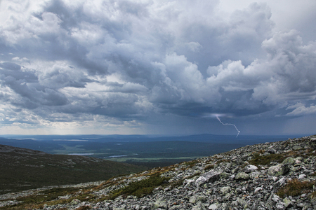 Thunderstorm with lightning and heavy rain approaching Fell Pallastunturi in Finnish Lapland