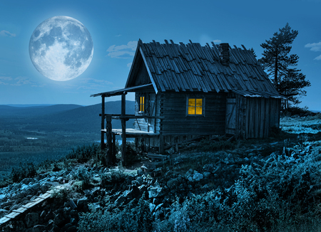 Santa Claus secret cottage on Lapland fell top in mysterious moonlight 版權商用圖片