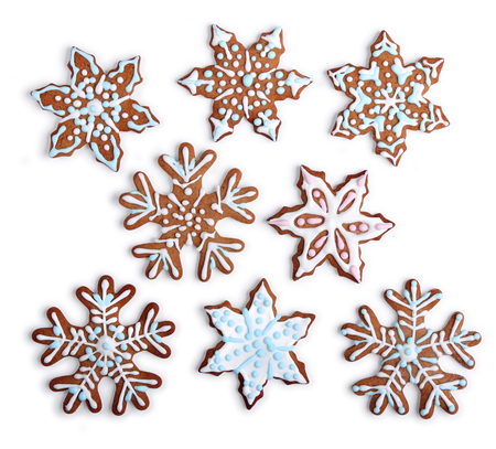 Homemade snowflake shaped gingerbread cookies with sugar icing, on white background isolated 版權商用圖片