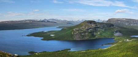 Panoramic view of Lake Kilpisjarvi and Malla fells, seen from Saanatunturi fell to North. Snowy mountain tops are in Sweden and Norway. 版權商用圖片