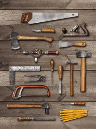 Old carpenter DIY hand tools on weathered wooden plank background, soft drop shadow Banque d'images