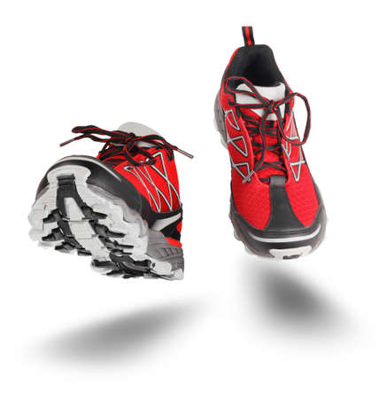 Red running sport shoes seen front, isolated on white background Standard-Bild