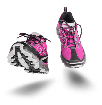 Pink running sport shoes seen front, isolated on white background