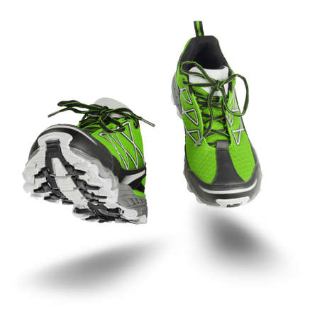Green running sport shoes seen front, isolated on white background Standard-Bild