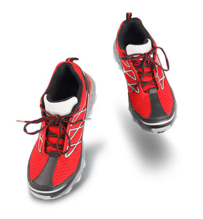Red running sport shoes going forward, exercising concept, isolated on white background