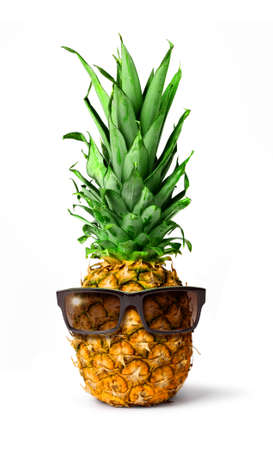 Fresh tropical pineapple fruit with sunglasses, holiday concept, isolated on white background