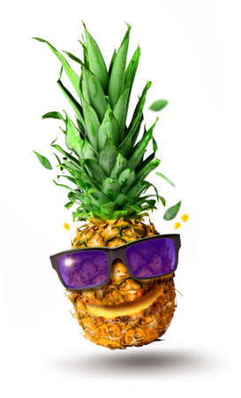 Funny tropical jumping pineapple fruit with sunglasses, holiday concept, isolated on white background