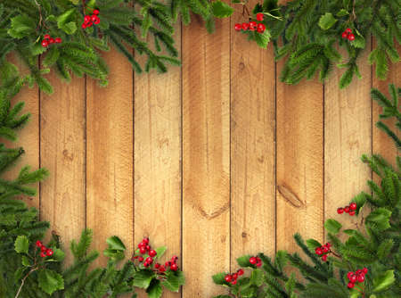 Green Christmas tree branches and red hawthorn berries on warm brown wooden vertical plank wall background
