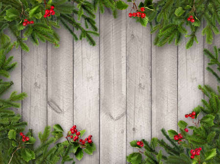 Green Christmas tree branches and red hawthorn berries on grey wooden vertical plank wall background