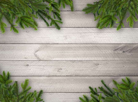 Green Christmas tree branches on grey wooden horizontal plank wall background Standard-Bild