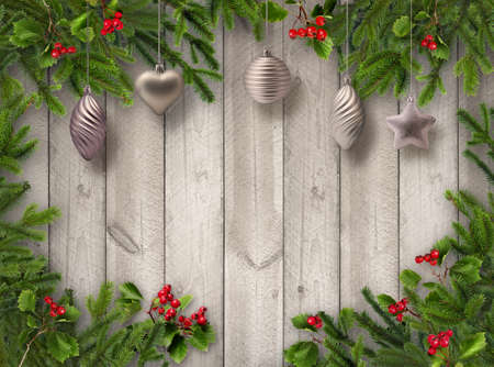 Green Christmas tree branches, red hawthorn berries and silver decoration balls on grey wooden vertical plank wall background