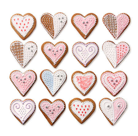 Sweet Christmas heart shaped gingerbread cookies collection with colorful sugar icing decoration, isolated on white background