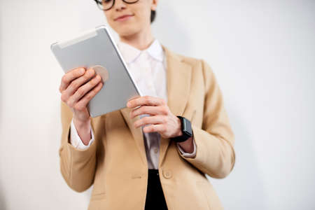 mid age businesswoman working on new project at modern office with a tablet
