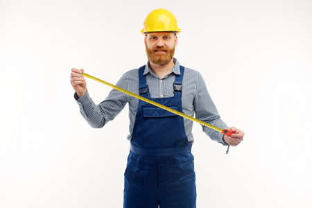 Engineer holding a construction tape measure on a white background.