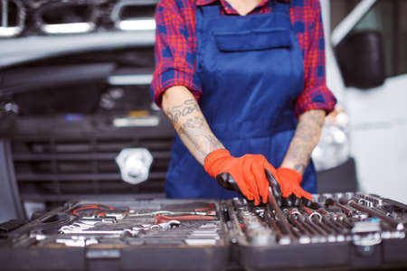 Close up of a woman checking the instruments she has.