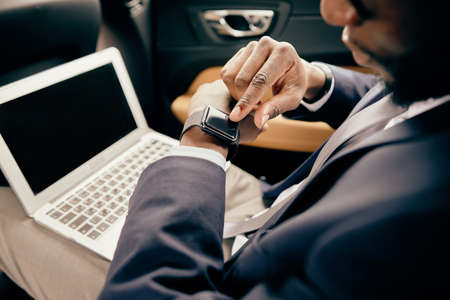Close up of a man looking at watches in car. Standard-Bild