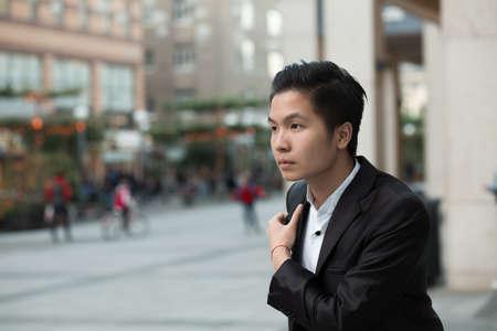 purposeful: Chinese elegant purposeful businessman in avenue Stock Photo