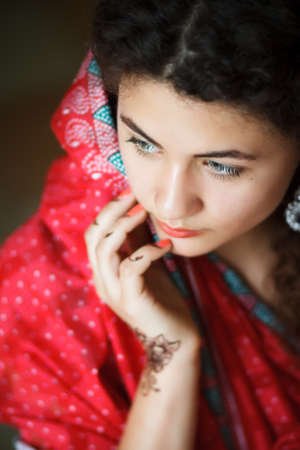 bracelet tattoo: Portrait of Indian girl in sari with pattern of henna on hands Stock Photo