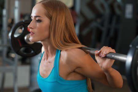 strong: Strong woman squat in gym