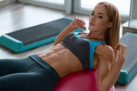 fitball: Strong cute woman doing exercises on fitball Stock Photo