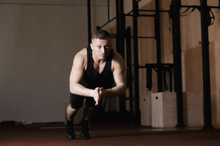 30 34 years: The athlete doing push-up with clap in gym Stock Photo