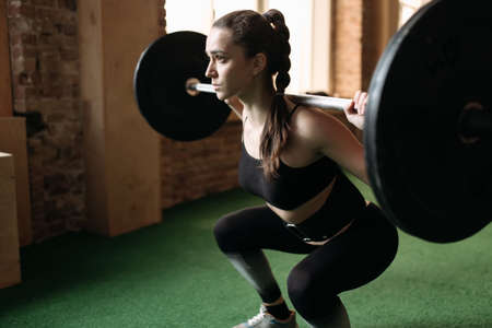 strong: Strong woman lifting barbell at the gym