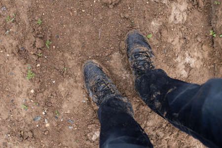 dirt: Shoes in dirt. Hard hiking. Stock Photo