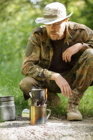 wood burner: Male tourist prepared dinner on a burner