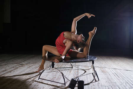 contortion: Graceful flexible performer woman doing artistic contortion