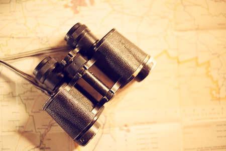 Vintage binocular on map background Reklamní fotografie