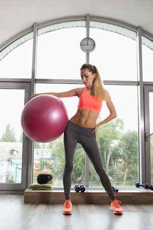 fitball: Woman holding fitball in a fitness studio Stock Photo